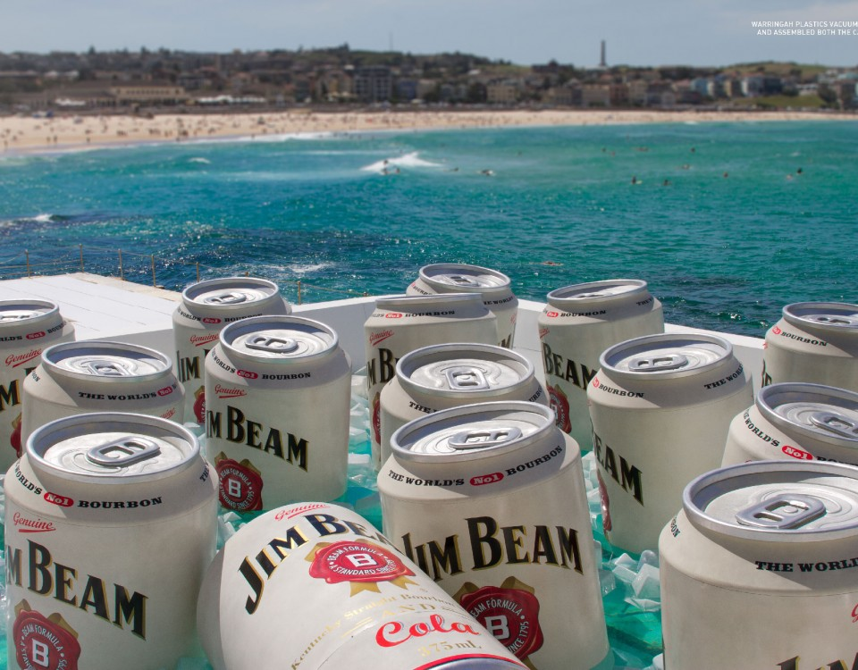 jim beam can by the beach
